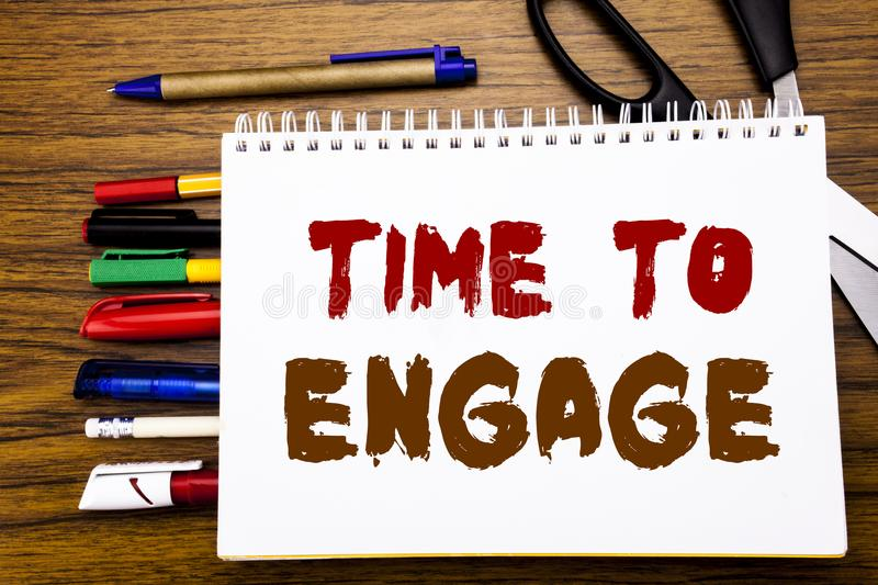 Word, writing Time To Engage. Business concept for Engagement Involvement Written on notebook, wooden background with office equip stock photo