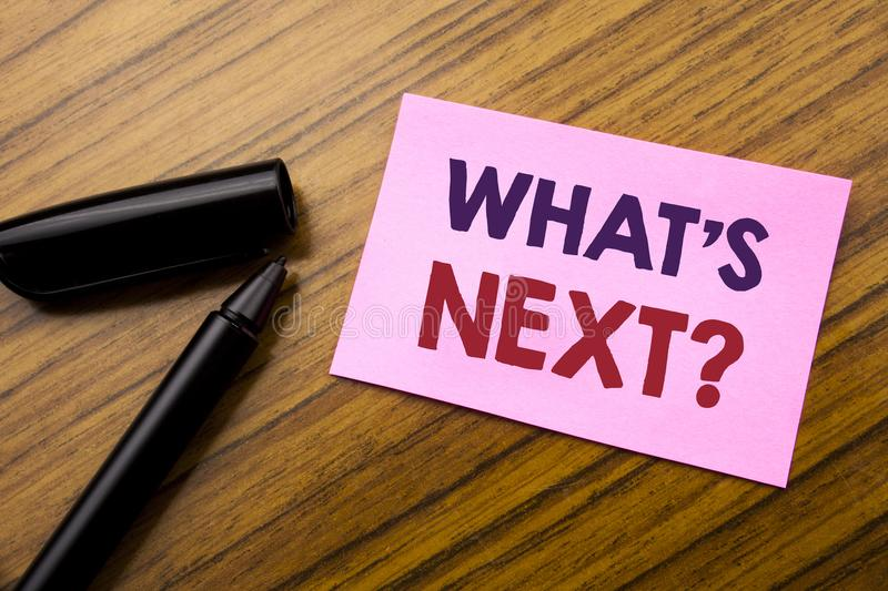 Word, writing What is Next Question. Business concept for Next Future Plan Vision Progress Goal Guidance Written on sticky note re. D paper, wooden background royalty free stock image