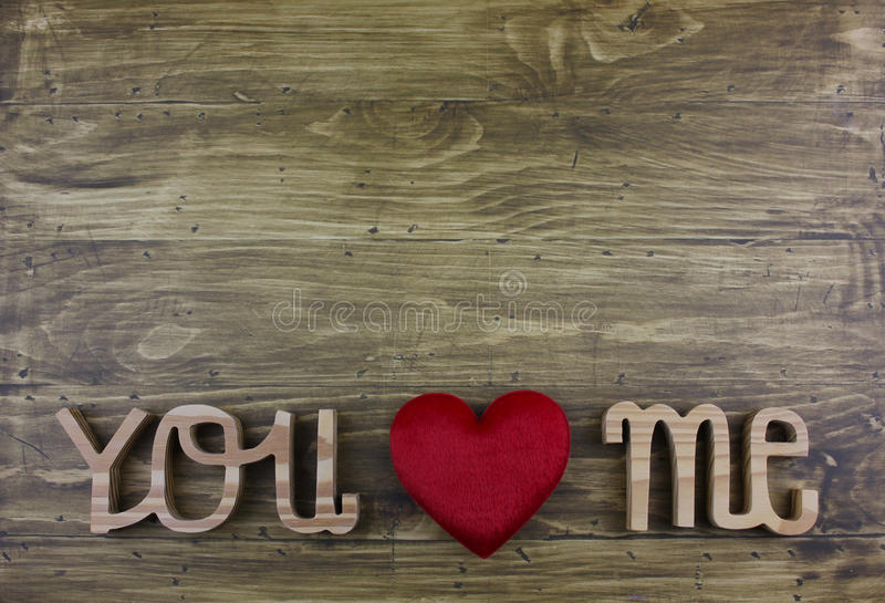 The word ` YOU LOVE ME` over the wooden board. stock photos