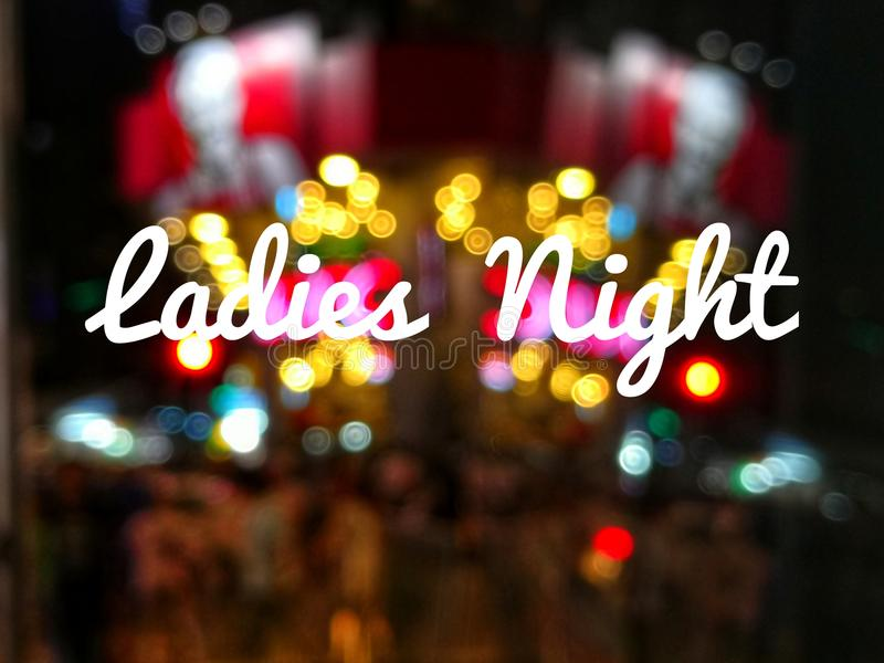 Wording Ladies Night. With blurred background of city royalty free stock photos