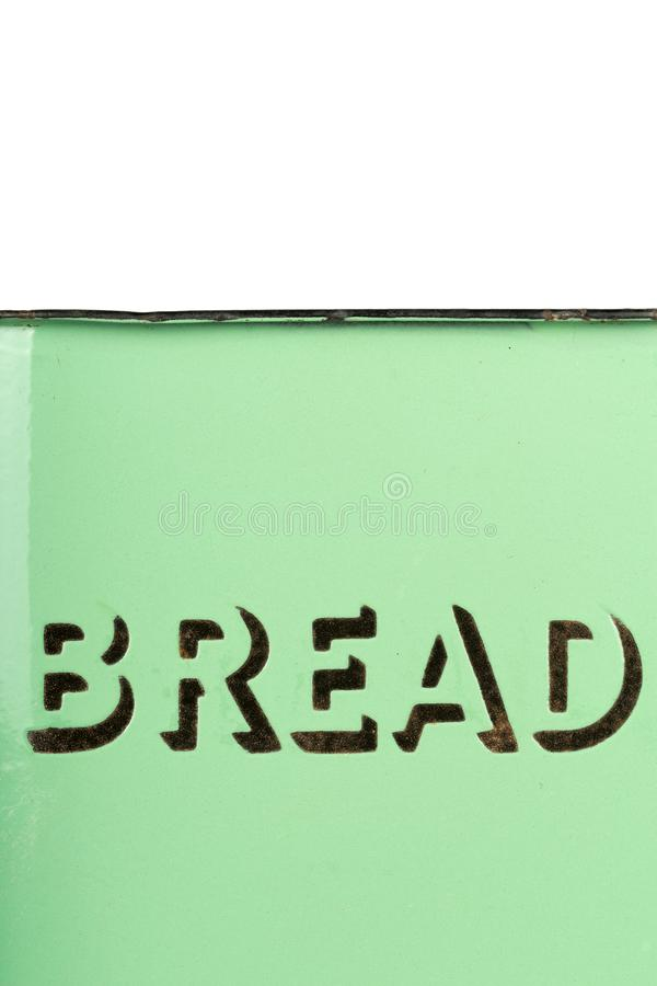 Wording on the side of a vintage 1930s green enamel bread bin. Potential use as background for recipe / menu / ingredients / bakery price list royalty free stock images