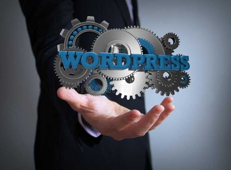 Wordpress gears businessman royalty free stock image