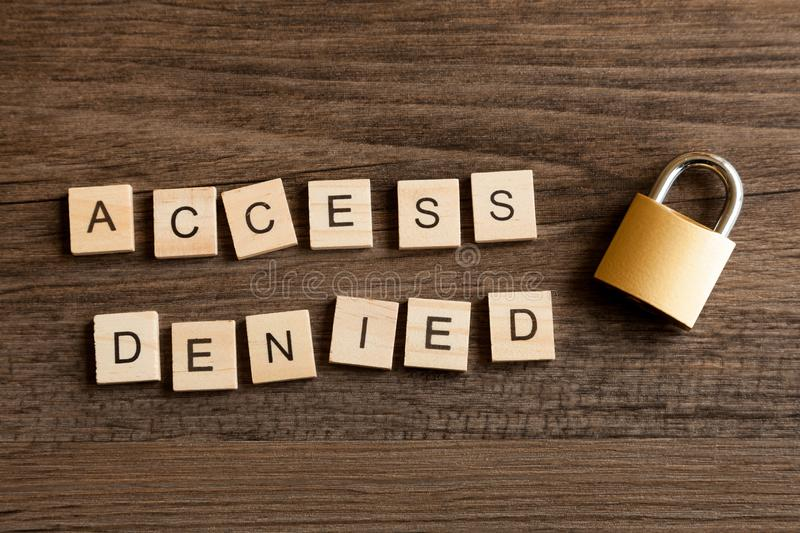 Access Denied with Locked Padlock. Words - Access Denied with a locked padlock stock images