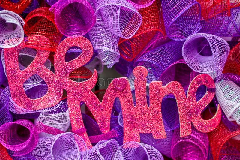 The words `be mine` written with glitter/Valentine`s Day gift royalty free stock images