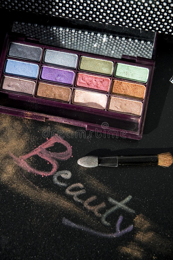 Words beauty with eyeshadow. Words beauty write with eyeshadow on black background stock photos