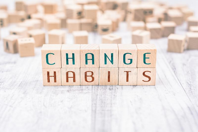 The Words Change Habits Formed By Wooden Blocks On A White Table, Reminder Concept. The Words Change Habits Formed By Wooden Blocks On White Table, Reminder royalty free stock photo
