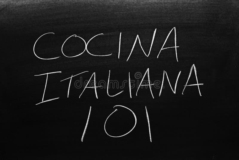 Cocina Italiana 101 On A Blackboard. Translation: Italian Cooking 101. The words Cocina Italiana 101 on a blackboard in chalk. Translation: Italian Cooking 101 stock photos