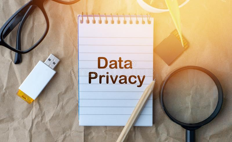 Words DATA PRIVACY on wooden paper background. Business and education concept stock photo