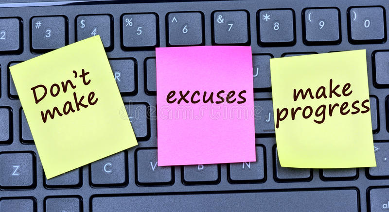 The words Don`t make excuses make progress on notes royalty free stock photography