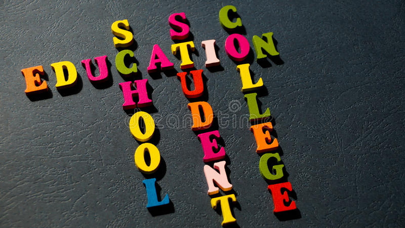 The words Education, School, Student, College built of colorful wooden letters on a dark table. royalty free stock photo