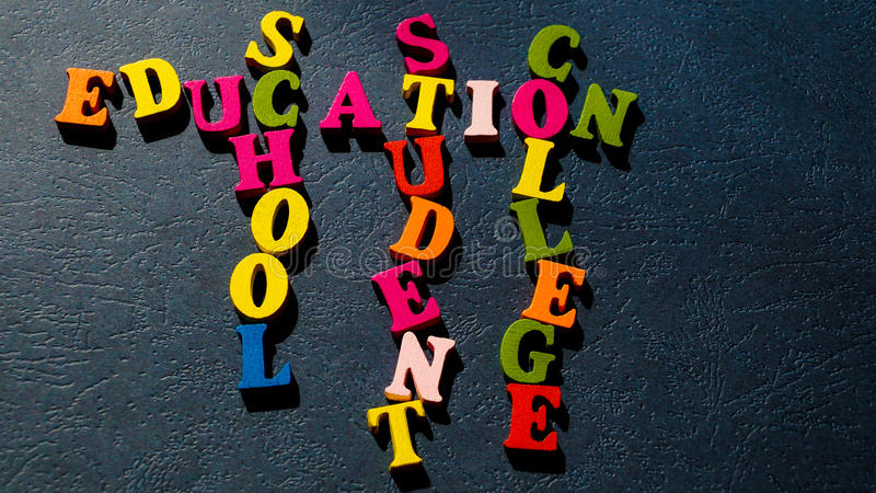 The words Education, School, Student, College built of colorful wooden letters on a dark table. stock images