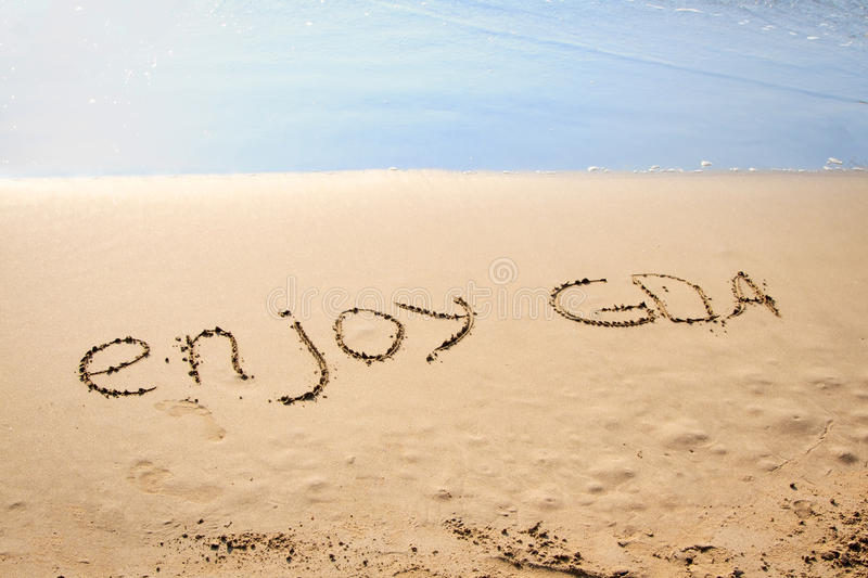 The Words Enjoy Goa Written in the Sand royalty free stock photos