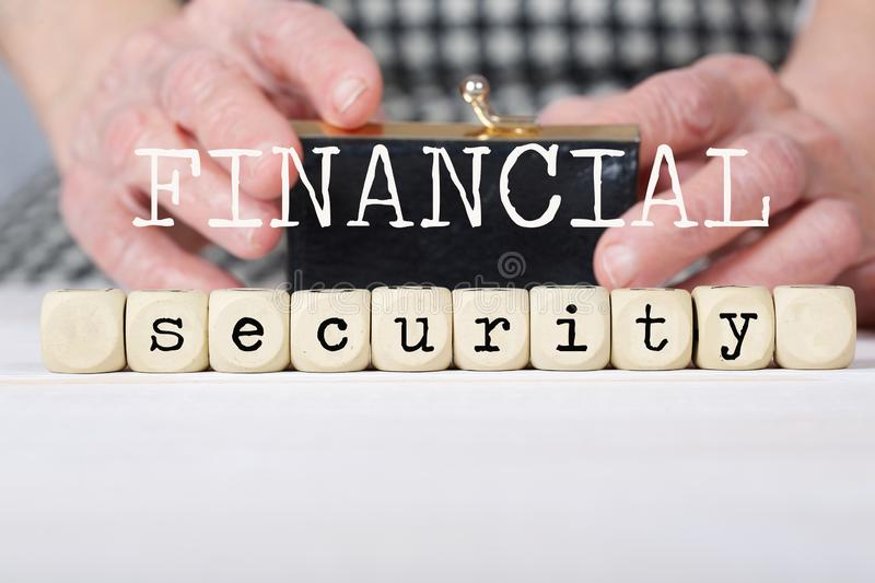 Words FINANCIAL SECURITY composed of wooden made dices royalty free stock photo