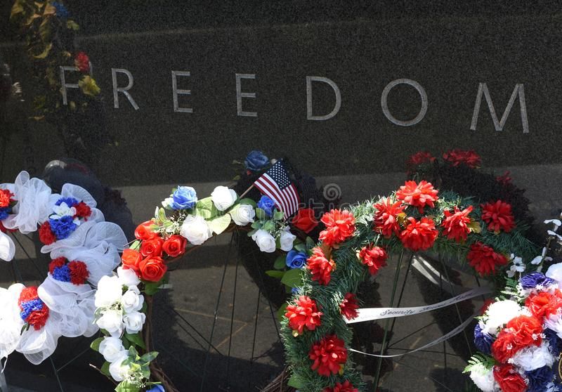 Words `Freedom` an part from the inscription `freedom is not free` on Korean War Memorial on the National Mall. Washington, DC - June 01, 2018: Words `Freedom` stock photos
