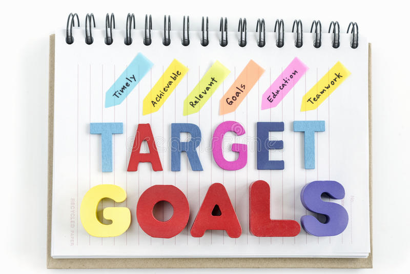Words goals target on notebook over white background stock images