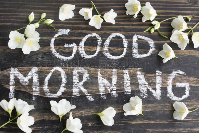 Words Good Morning with Jasmine Flowers stock photos