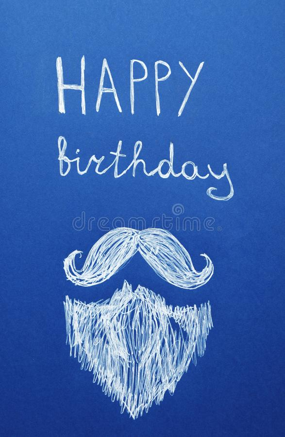 Words HAPPY BIRTHDAY and drawn beard with mustache on blue background royalty free stock image