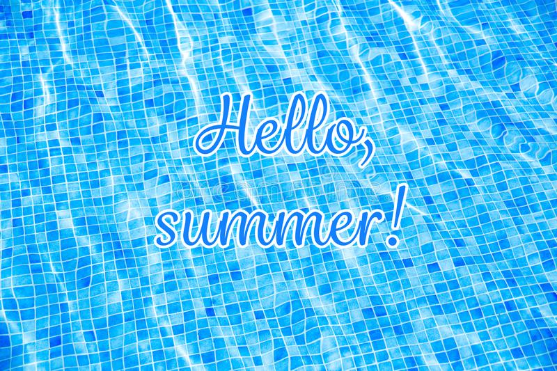 Words Hello Summer on blue ripped water background Swimming pool Summer vacation. Top view Copy space royalty free stock photos