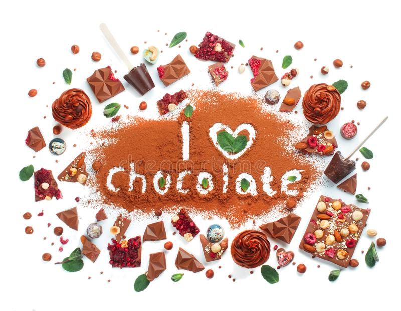 Words I love Chocolate on cocoa powder surrounded by pieces of m stock photo