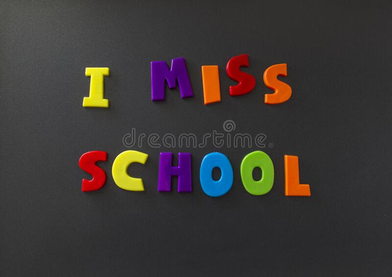 The words I miss school written on a refrigerator door with magnet letters stock images