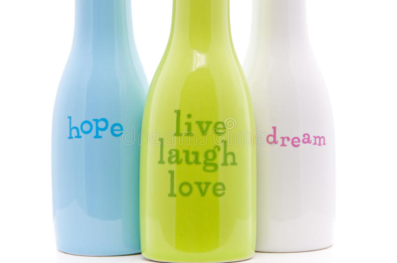 Words of Inspiration. Inspirational Words Ceramic Bottles on White for inspirational purposes and abstract presentation