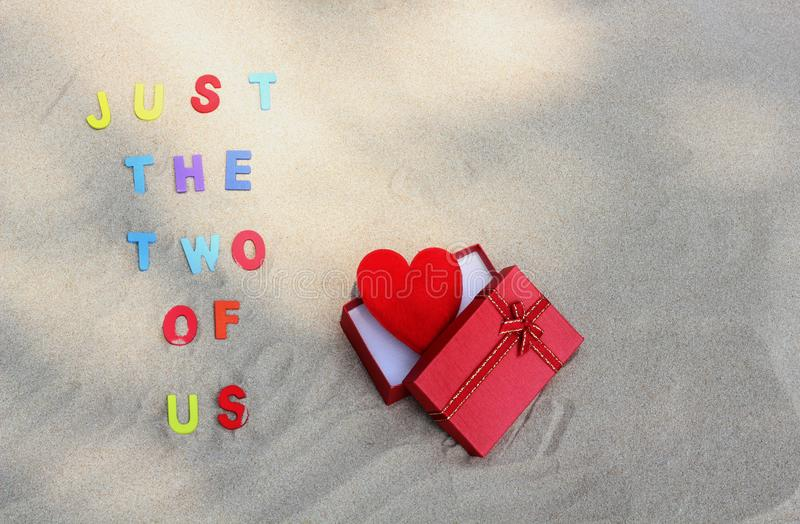 The words `Just the two of us` on sand. stock image