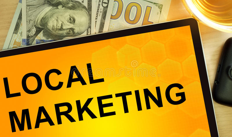 Words Local Marketing on tablet. Business concept royalty free stock image