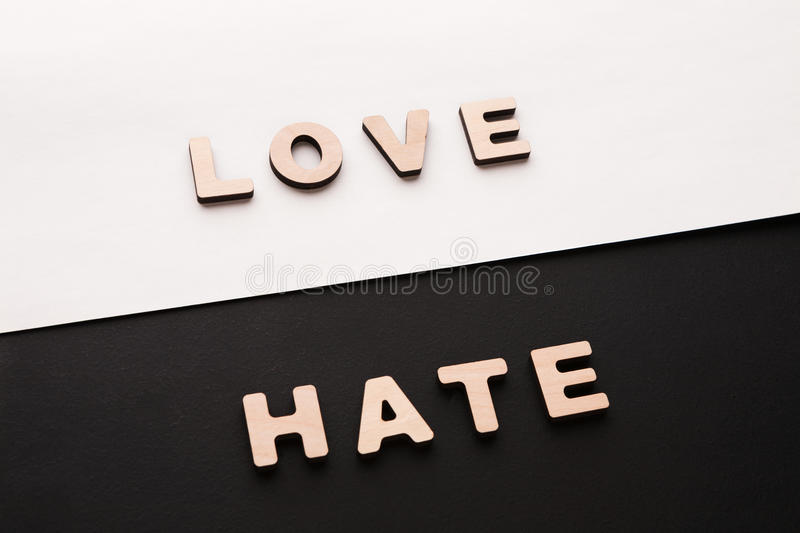 Words Love and Hate on contrast background. Opposite feelings, strong emotions concept royalty free stock photography