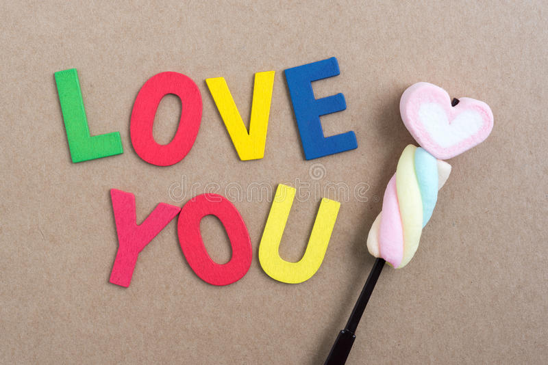 Words love you with valentine candy stock images