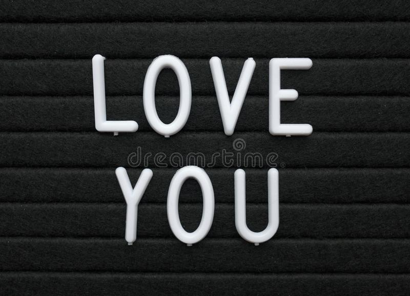 The words Love You in white text on a letter board as a romantic gesture royalty free stock photos