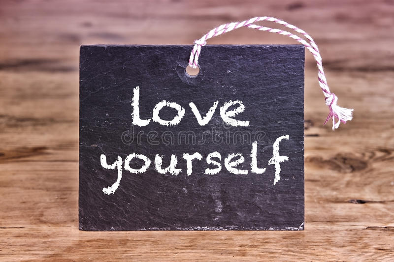 The words Love Yourself written on chalk board royalty free stock images
