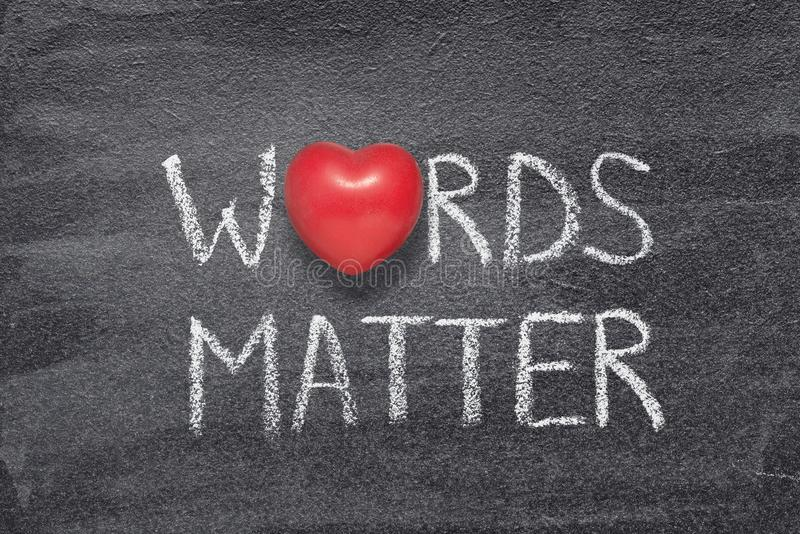 Words matter heart. Words matter phrase written on chalkboard with red heart symbol stock photos