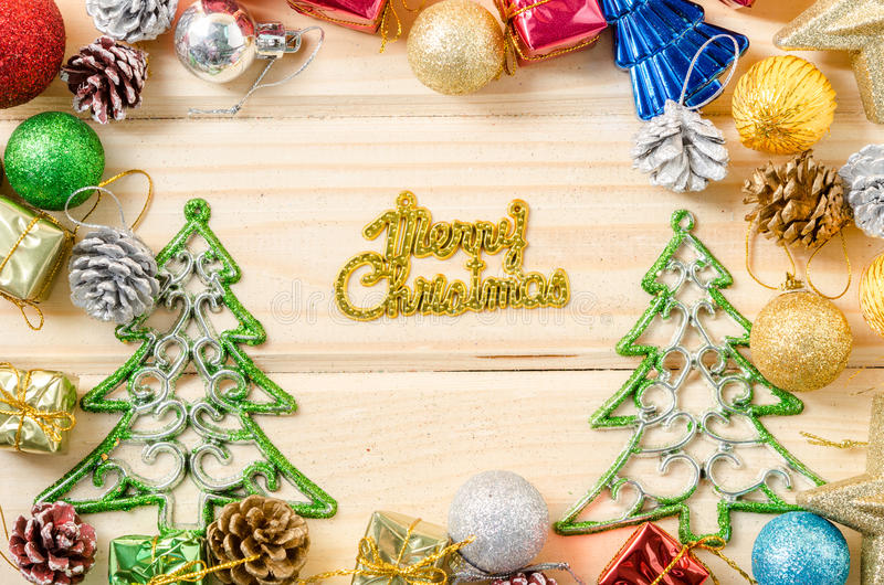 The words merry christmas with christmas decorations. The words merry christmas with christmas decorations on wooden background stock photo