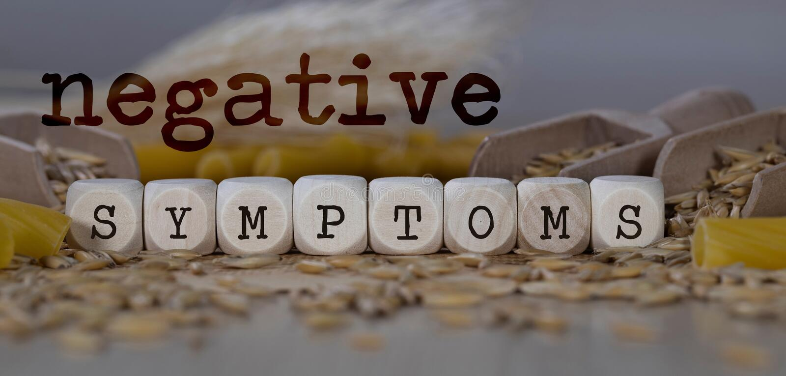 Words NEGATIVE SYMPTOMS  composed of wooden dices. Rye grains in the background. Closeup, allergen, allergy, deficiency, autoimmune, disorders, celiac, cereals stock photography