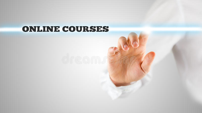 Words - Online Courses - on a virtual interface. The words - Online Courses - on a virtual interface contained in a narrow navigation bar with a man activating royalty free stock photography