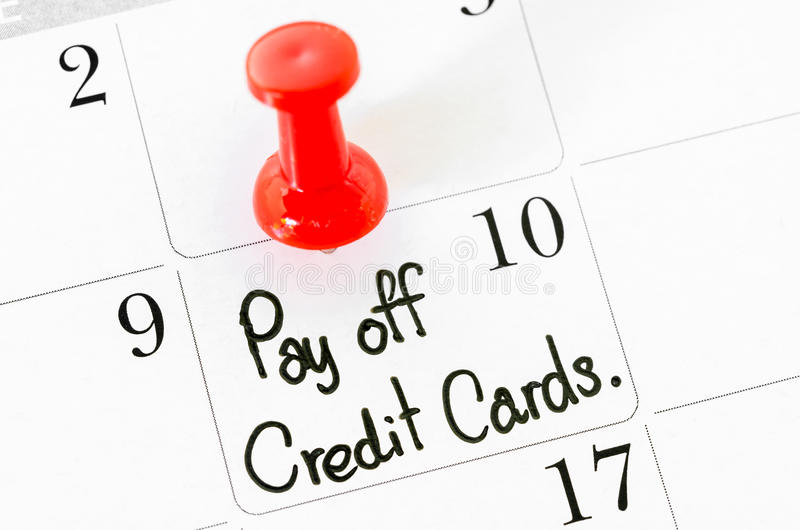 The words Pay off Credit Cards. The words Pay off Credit Cards written on a Calendar stock photography