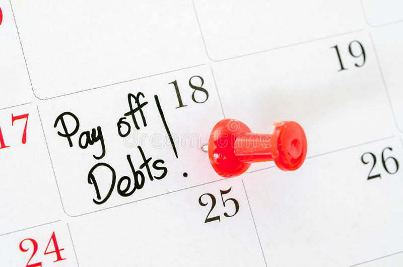 The words Pay off Debts written. The words Pay off Debts written on a Calendar stock images