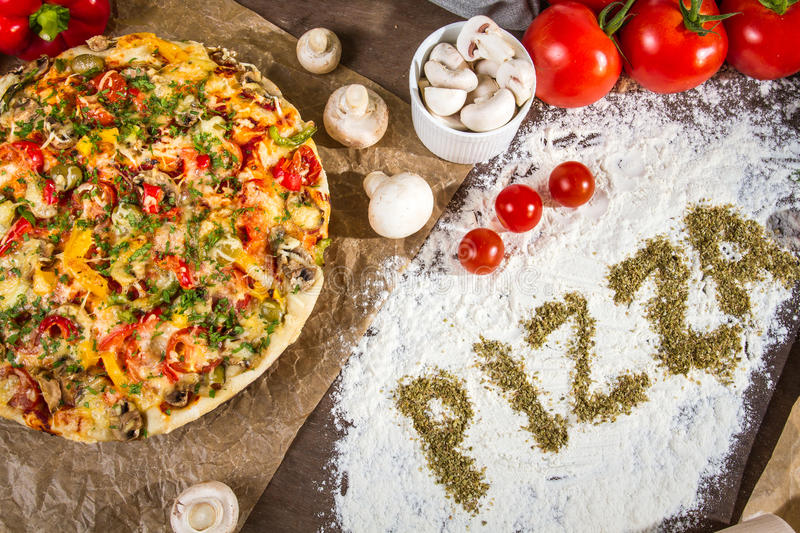 The words 'pizza' written on the flour stock image
