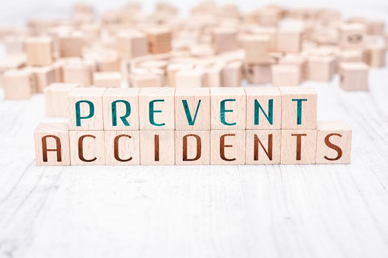 The Words Prevent Accidents Formed By Wooden Blocks On A White Table. The Words Prevent Accidents Formed By Wooden Blocks On White Table royalty free stock images