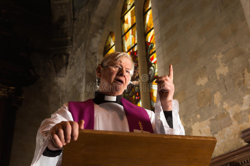 Words of a priest. Vicar talking on his pulpit in a 17th century old church royalty free stock photos