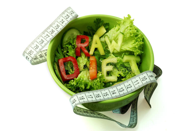 Words raw diet composed of slices of different vegetables. On white background royalty free stock photo