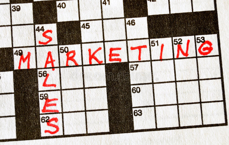 Download The Words Sales And Marketing On Crossword Puzzle Stock Photo - Image: 10419568