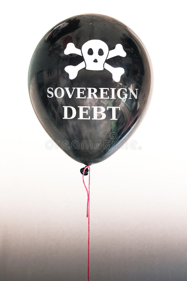 The words sovereign debt in white and a skull and cross bones on a balloon illustrating the concept of a debt bubble. The words sovereign debt and a skull and stock images