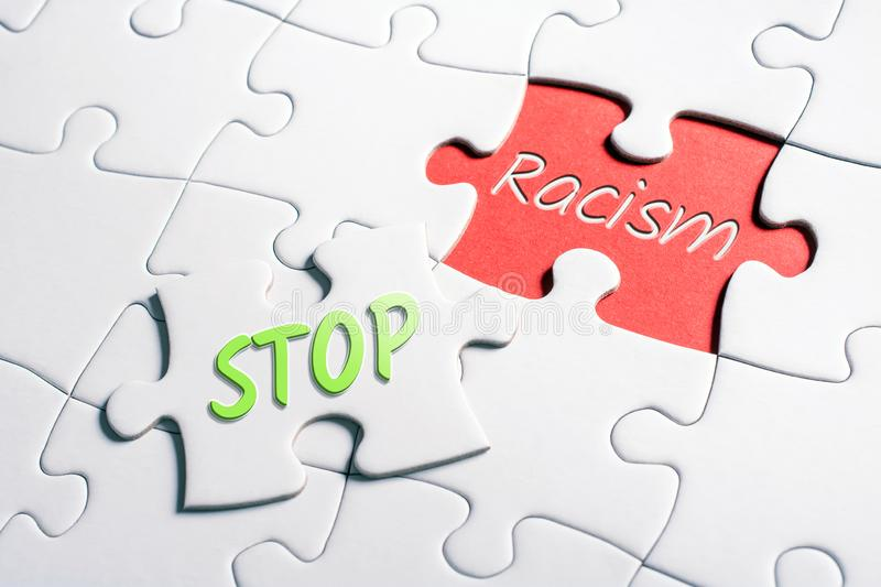 The Words Stop And Racism In Missing Piece Jigsaw Puzzle royalty free stock photos