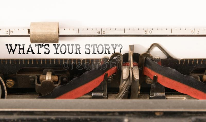 Words WHATS YOUR STORY written on vintage typewriter royalty free stock images
