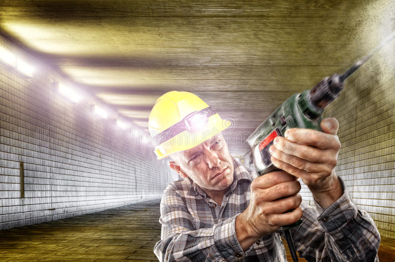 At work. Construction worker with drilling machine in tunnel stock photos