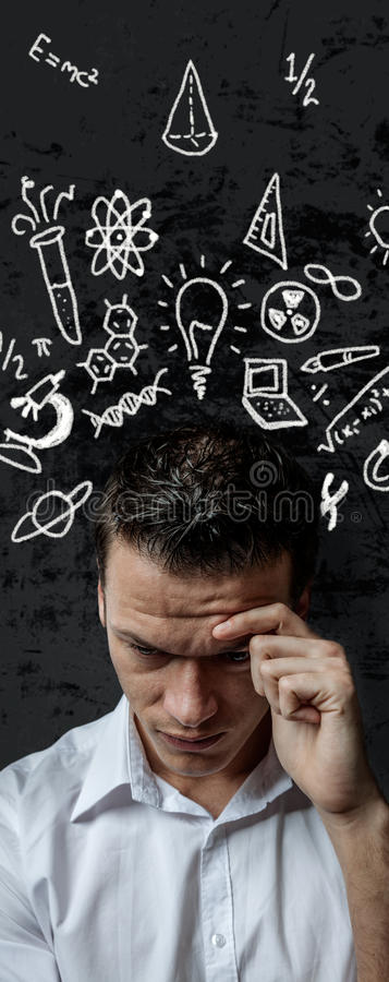 Work. Trouble thinking young male hard work stock image