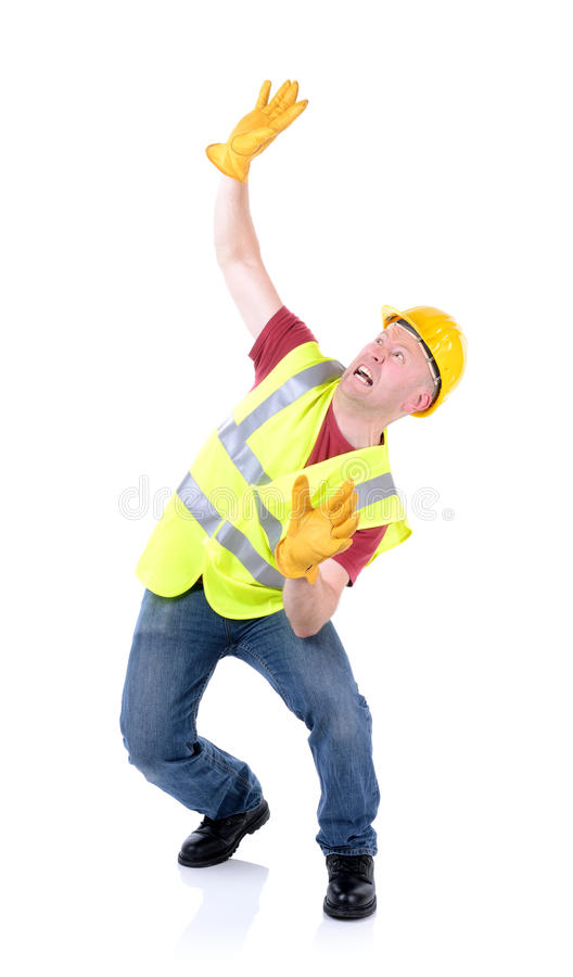 Work accident. Construction worker involved in a accident isolated on white stock image