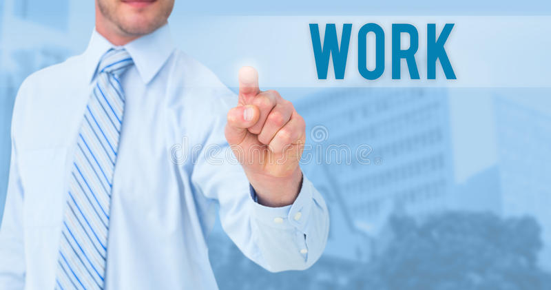Work against low angle view of city buildings on sunny day. The word work and businessman in shirt pointing with his finger against low angle view of city stock image