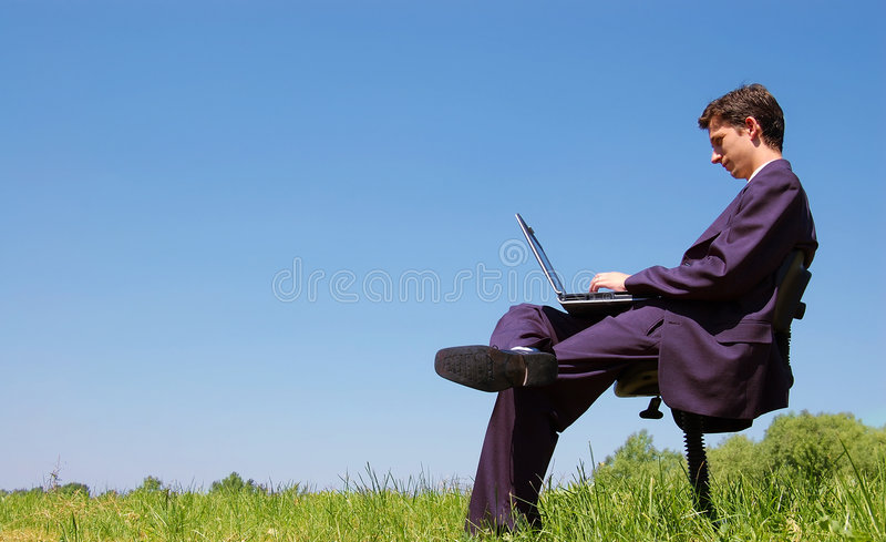Work anywhere. Businessman working in the nature